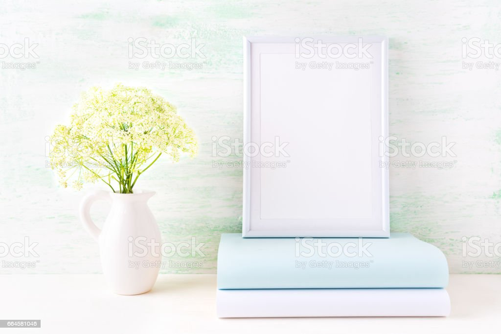 White frame mockup with pale mint book royalty-free stock photo