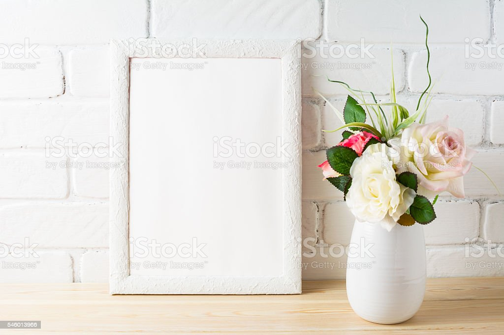 White frame mockup with tender pink roses bunch stock photo