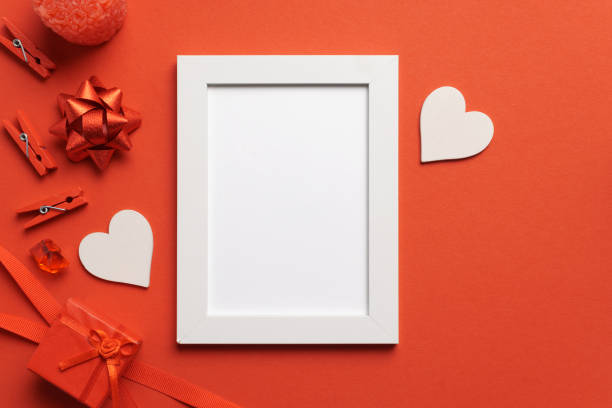 White Frame on Red Background Love Mockup stock photo