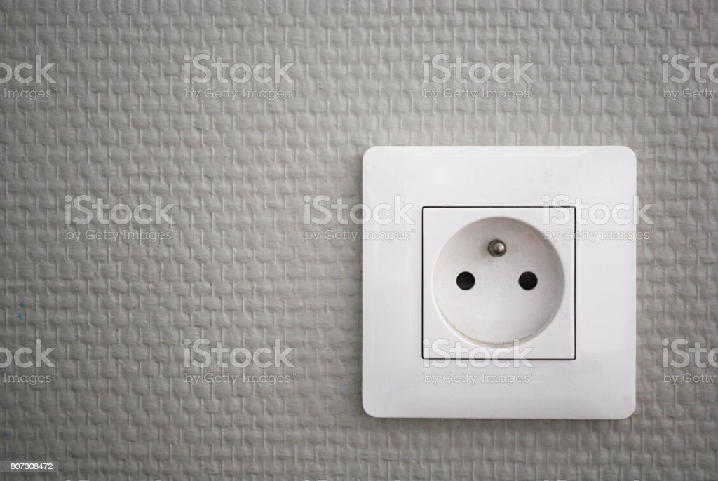 White french electrical outlet/plug on a wall. royalty-free stock photo