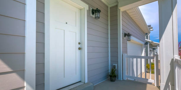 White front door and porch of home on a sunny day stock photo