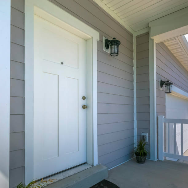 White front door of a home with porch and garage stock photo