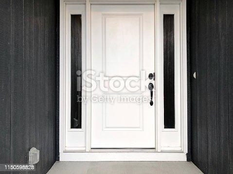 white front door black siding