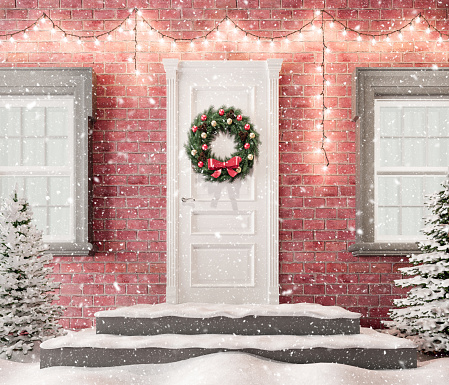 White front door with Christmas wreath and festive decorations on holidays at snowy night 3d render