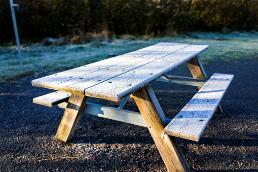 Stainless Steel Bathroom Vanity Cabinet, White Frost Ice Crystals On Wooden Picnic Table In Morning Sunlight By Forest And Campground Park Stock Photo Download Image Now Istock