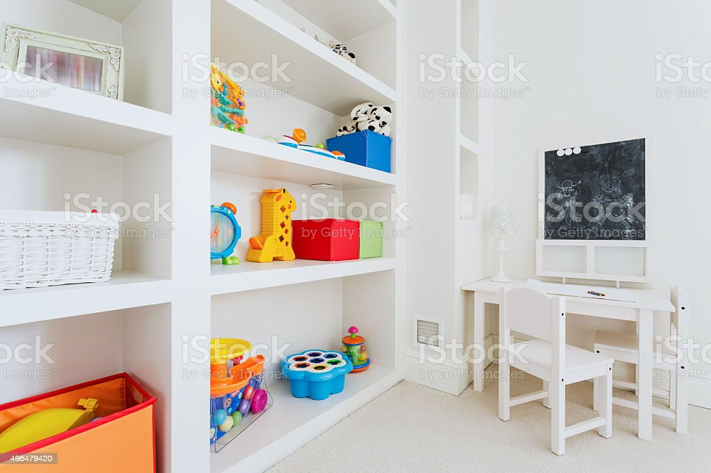 White furnitures in child room stock photo