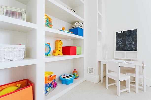 white furnitures in child room - opruimen stockfoto's en -beelden