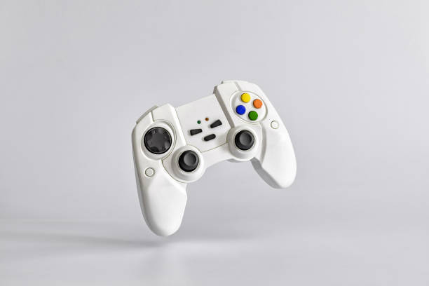 white gamepad on white uniform background. minimalism. copy space for text - gaming zdjęcia i obrazy z banku zdjęć