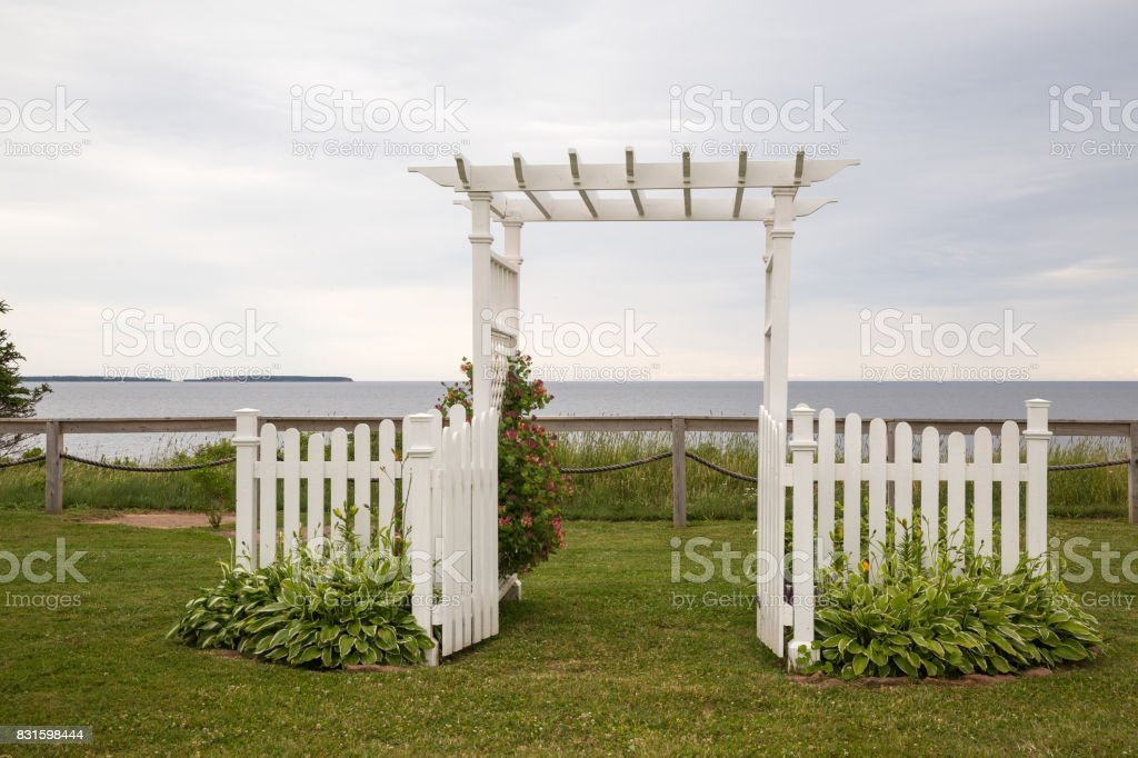 White Garden arch looking out to sea stock photo