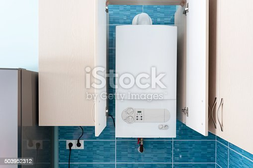 istock White gas boiler mounted in wall cupboard 503952312