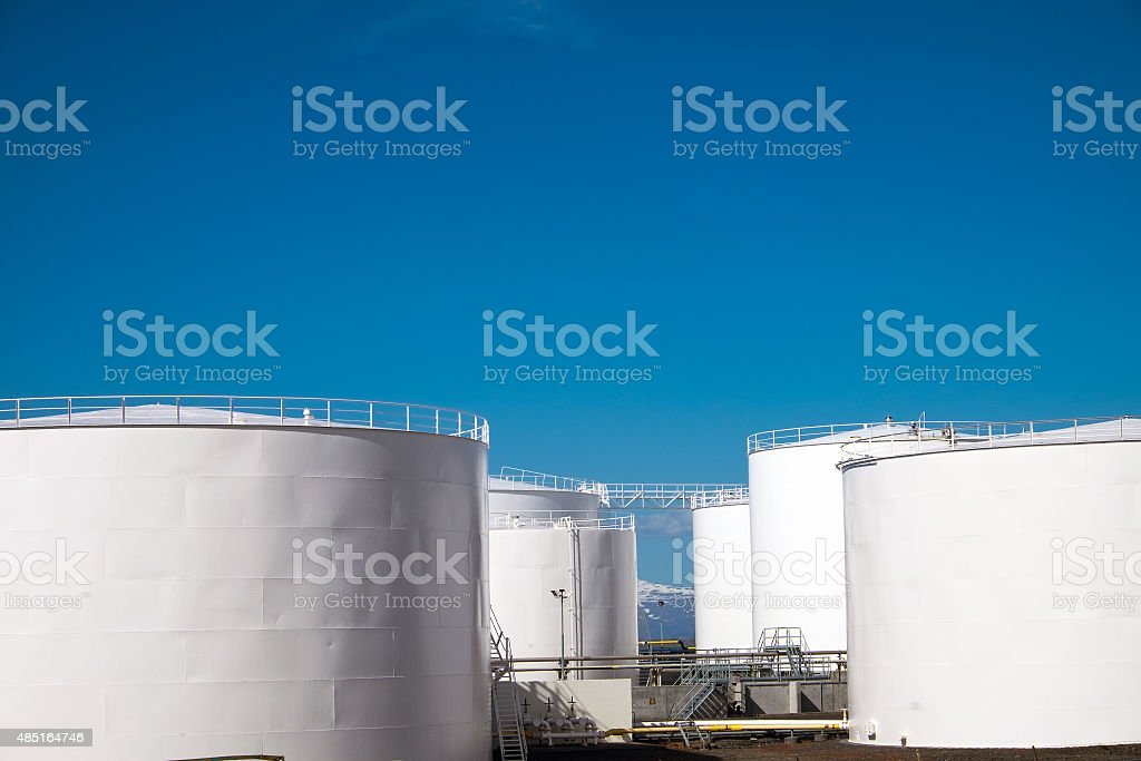 White gas storage tanks stock photo