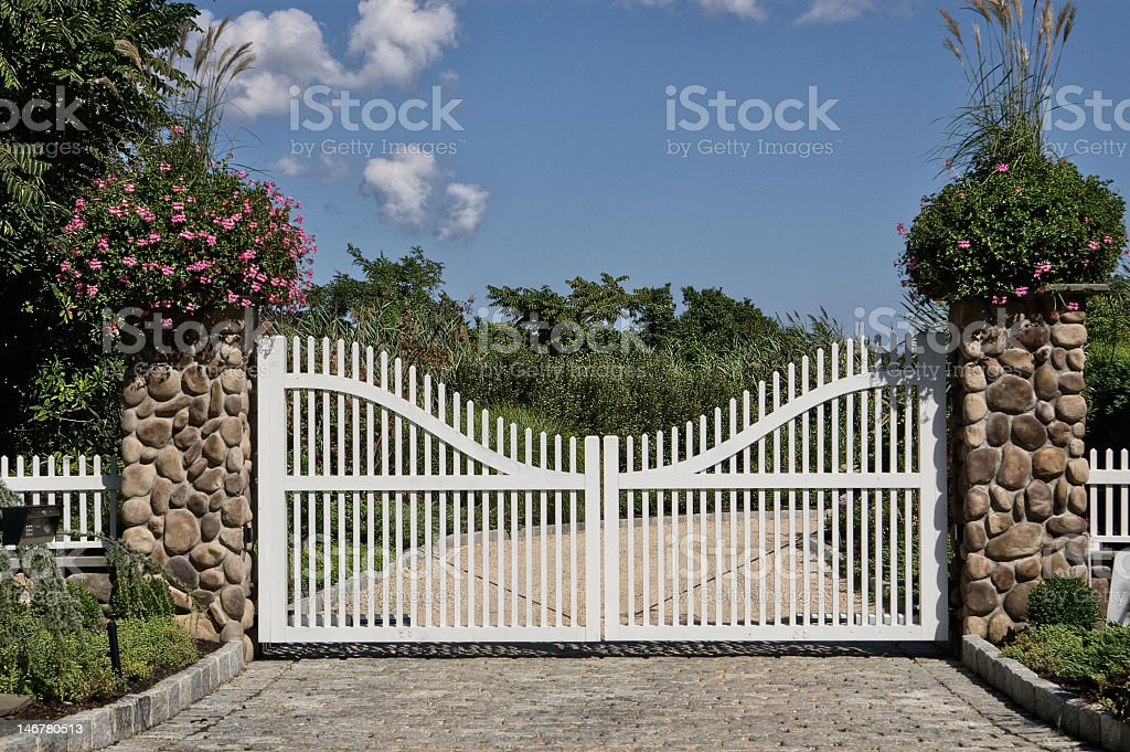 White gate in front of a house stock photo