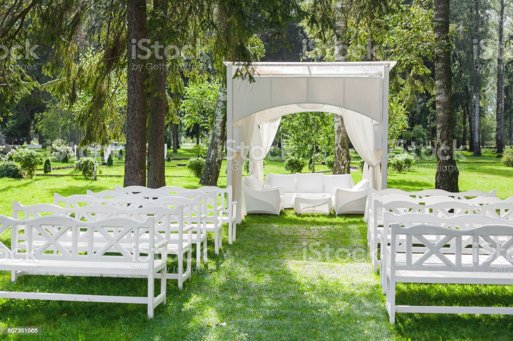 Sensational White Gazebo And Rows Of Benches On The Lawn In Park Place Alphanode Cool Chair Designs And Ideas Alphanodeonline