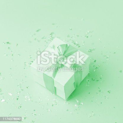 istock White gift box and confetti with copy space for text. fashion and shopping concept. wedding, marriage or birthday composition. flat lay, top view, neo mint pastel background 1174378592