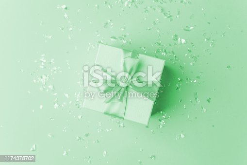 istock White gift box and confetti with copy space for text. fashion and shopping concept. wedding, marriage or birthday composition. flat lay, top view, neo mint pastel background 1174378702