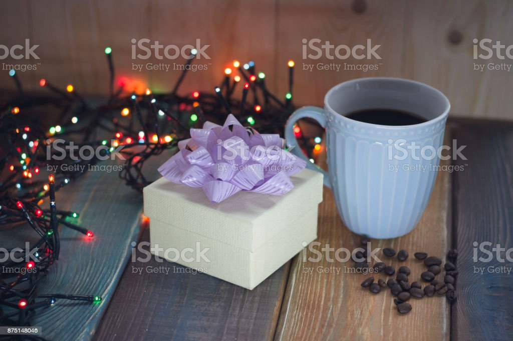 White gift box, blue cup, coffee beans on the table'r'n'r'n'r'n stock photo