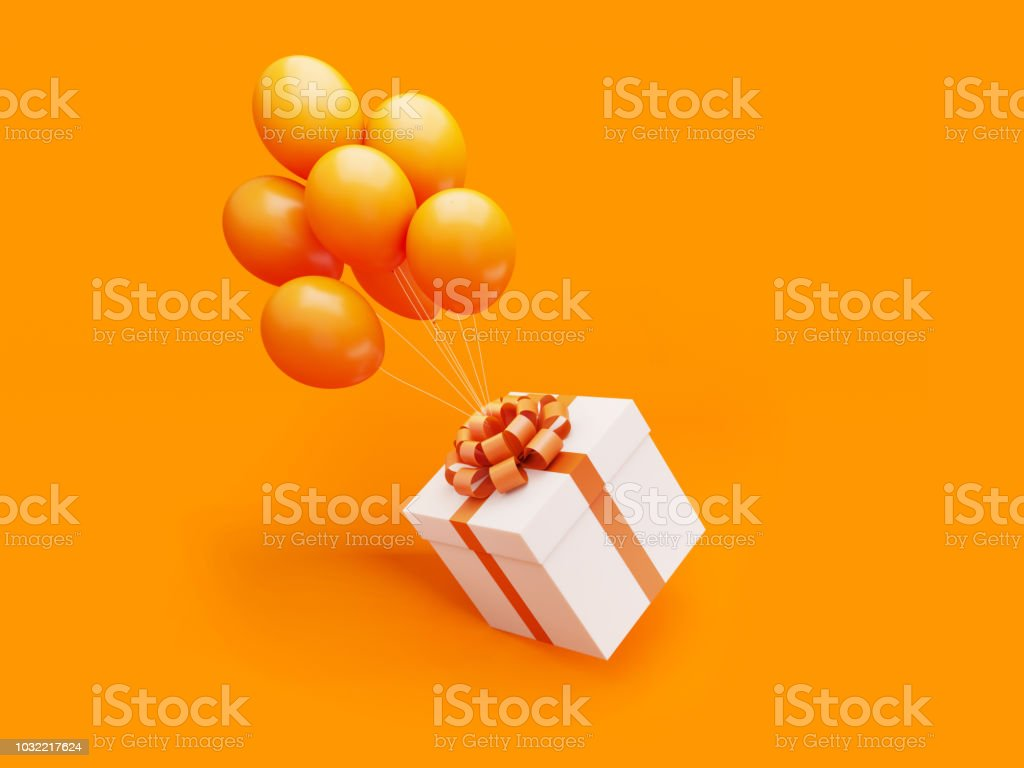 White Gift Box Tied with Orange Ribbon Is Carried Away By Orange Colored Balloons stock photo