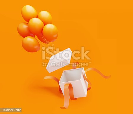 Whit gift box tied with orange colored ribbon is unwrapped by orange colored balloons on orange background.  Horizontal composition with copy space, Great use for Christmas, birthday and Valentine's Day related gift concepts.