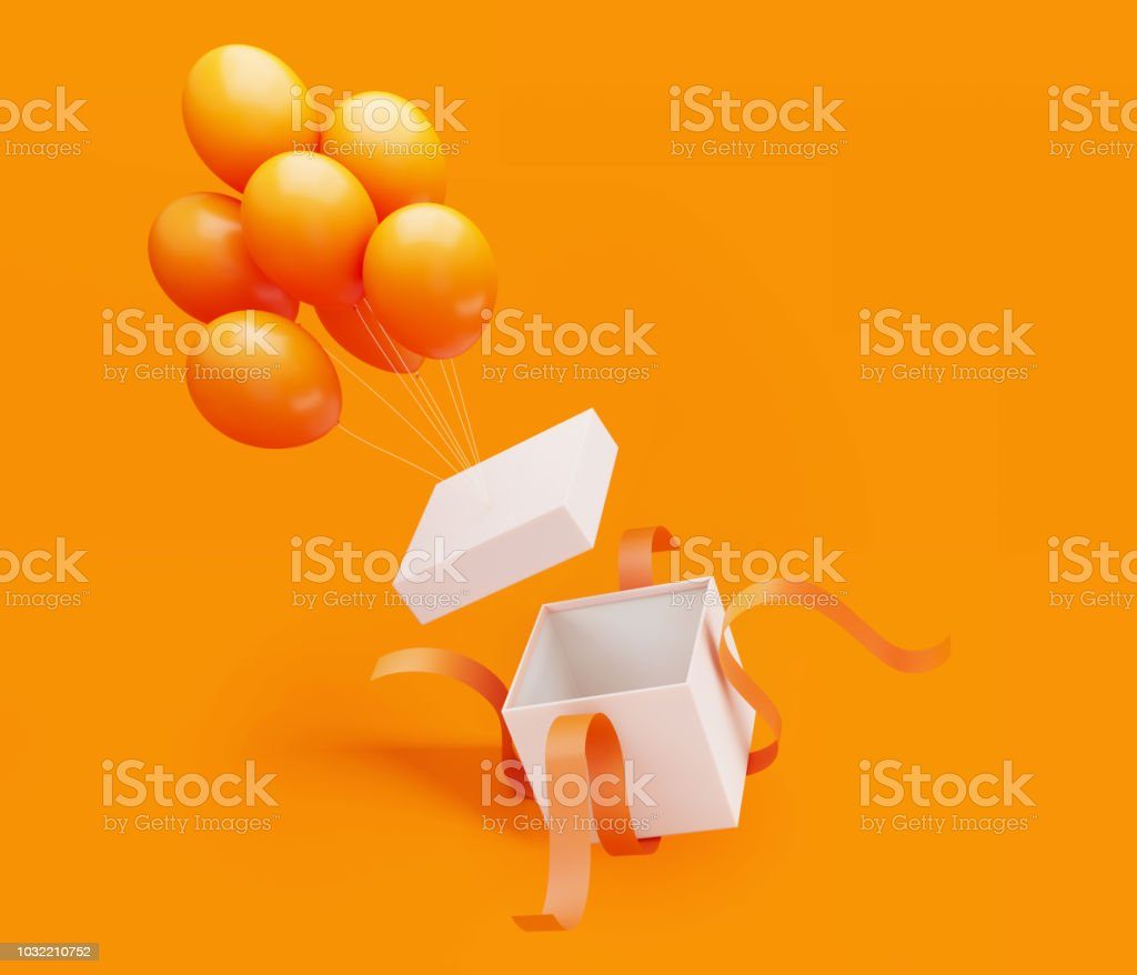 White Gift Box Tied with Orange Ribbon Is Unwrapped By Orange Colored Balloons stock photo