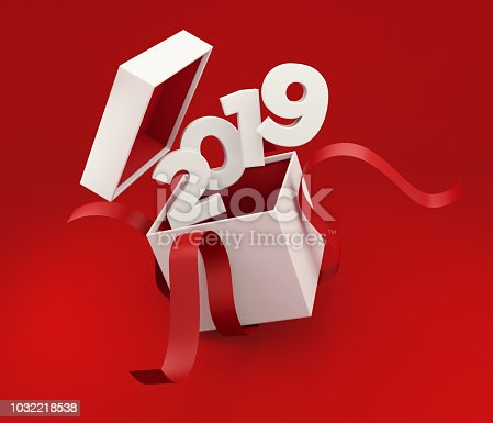 Whit gift box tied with red ribbon is being unwrapped on red background. 2019 is coming out of the box. Horizontal composition with copy space, Great use for Christmas and Valentine's Day related gift concepts.