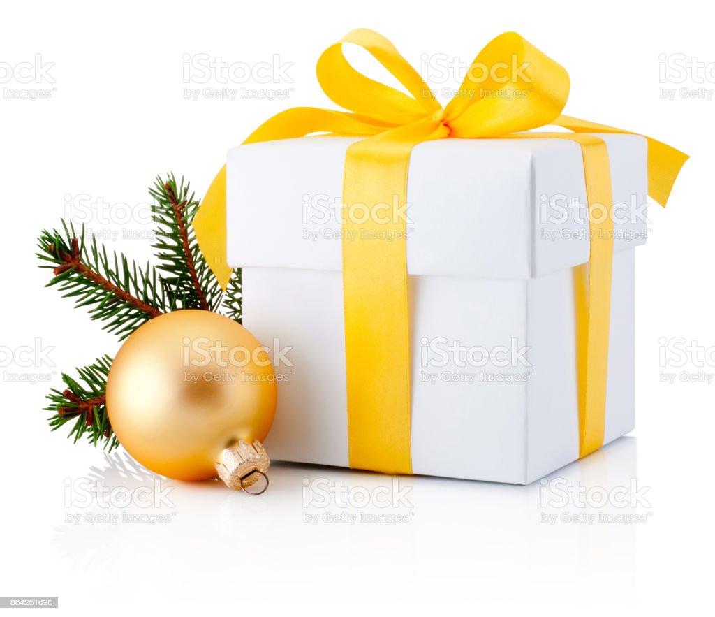 White gift box tied yellow ribbon and Christmas bauble Isolated on white background royalty-free stock photo