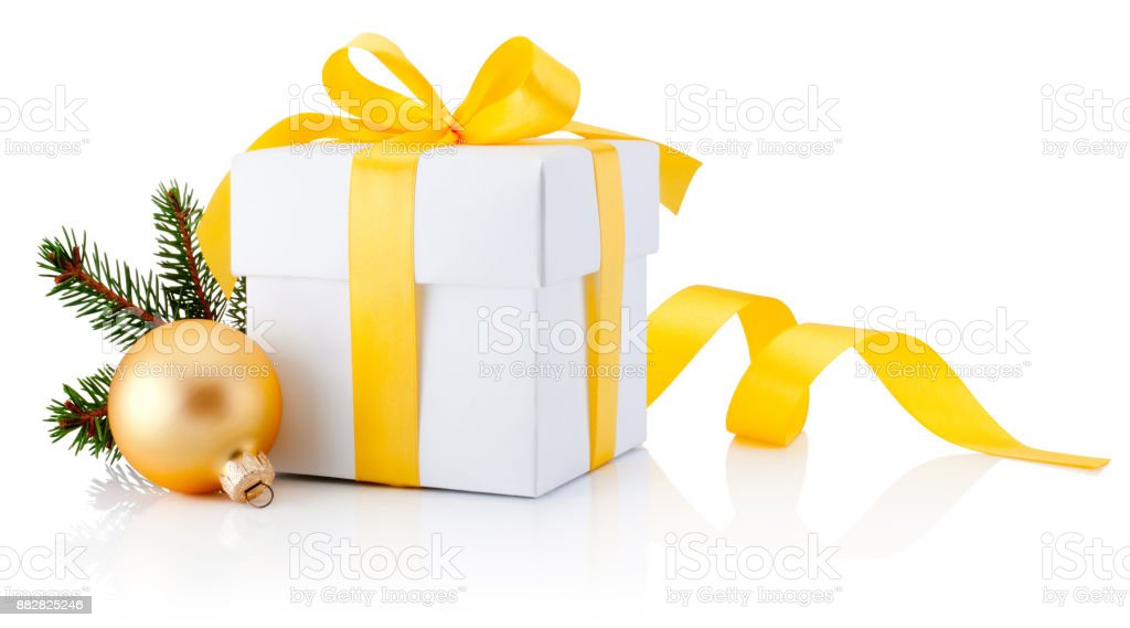 White gift box tied yellow ribbon and Christmas bauble Isolated on white background stock photo