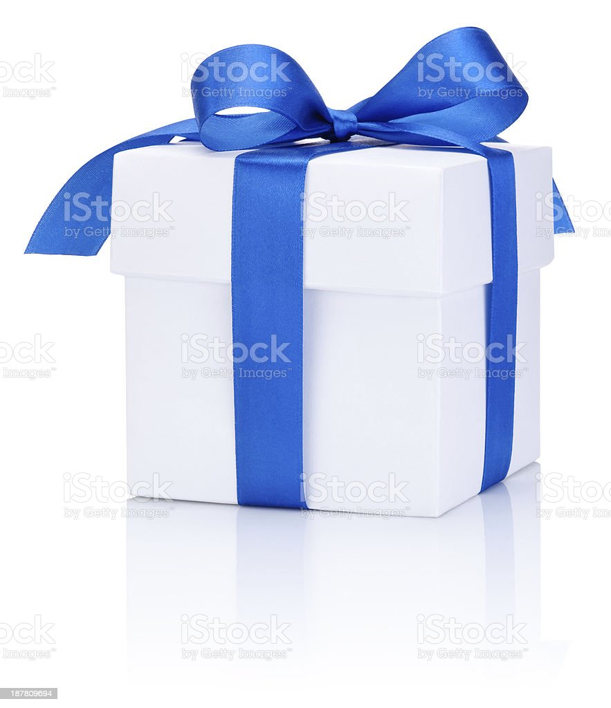 A white gift box with a blue bow stock photo