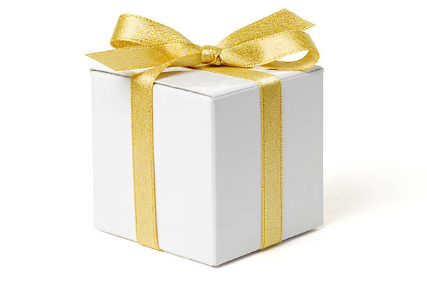 White Gift Box with Gold Bow White gift box tied with a gold ribbon bow.  Isolated on white with clipping path. gift box stock pictures, royalty-free photos & images
