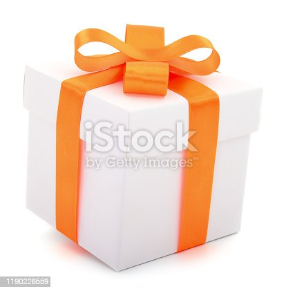 White gift box with orange ribbon isolated on white color background.