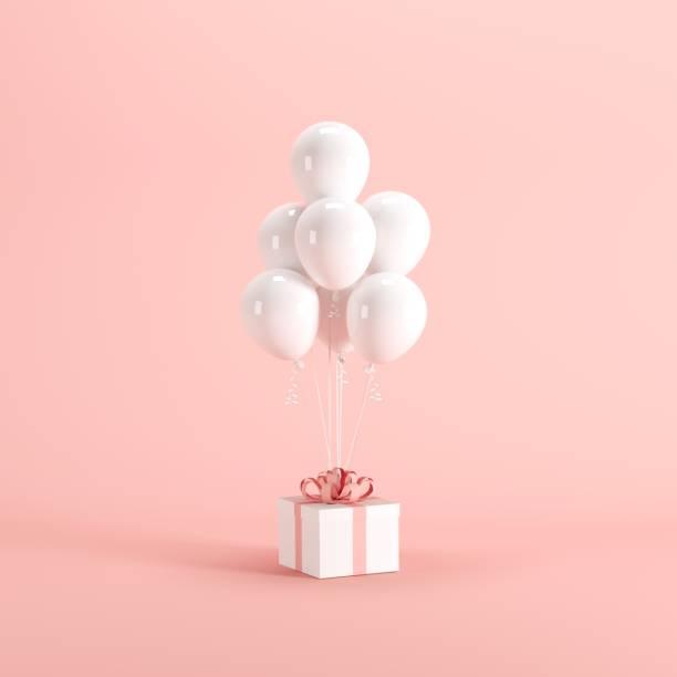 weißen geschenkbox mit rotem band und weißen ballon auf rosa hintergrund. minimale weihnachten-neujahr-konzept. - besondere geschenke stock-fotos und bilder