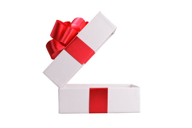 White gift box with red ribbon. Isolated stock photo