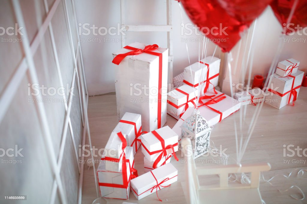 White Gift boxes with red stripe photo studio decor.
