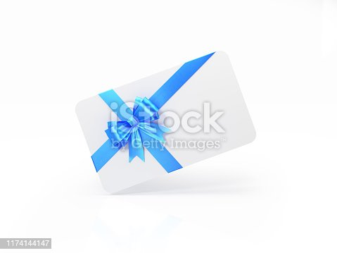 White gift card with blue bow tie on white background. Horizontal composition with and copy space.