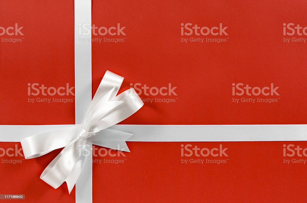 White gift ribbon on red paper royalty-free stock photo