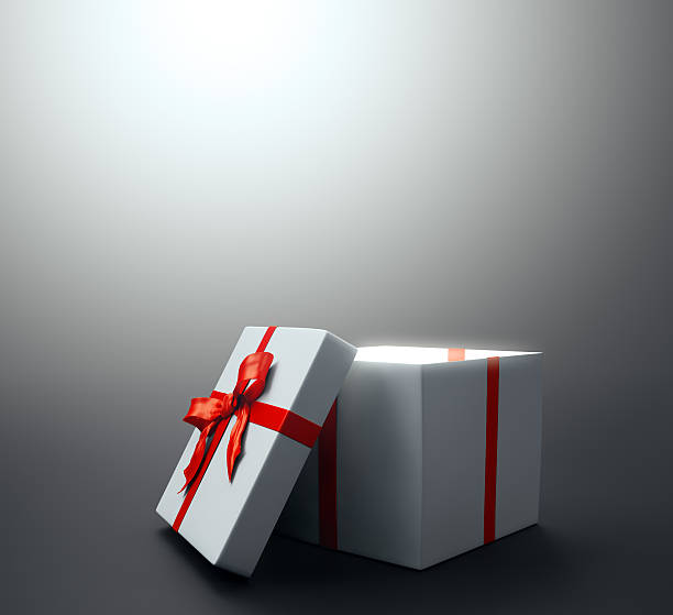 White gift with a red ribbon stock photo