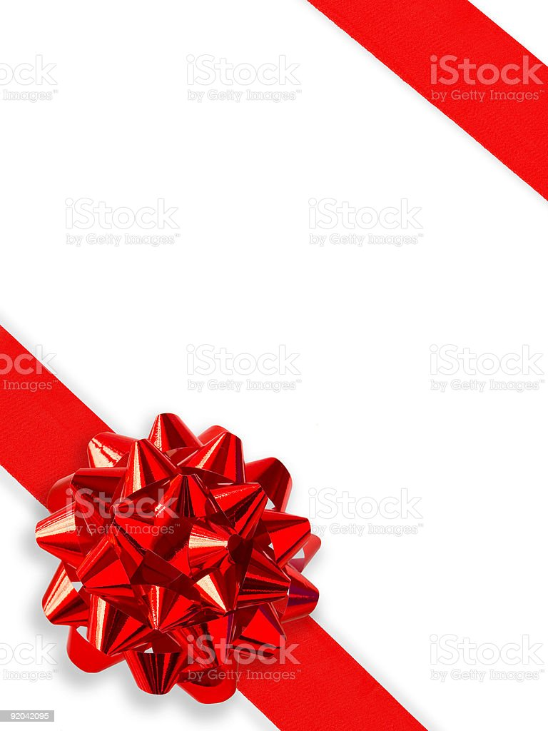 A white gift wrapped in red ribbon and a bow royalty-free stock photo