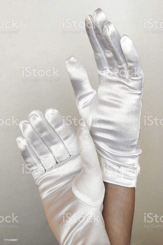 white glove hands stock photo