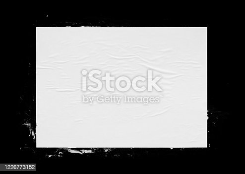 531421454 istock photo White glued wrinkled paper page isolated on black 1226773152