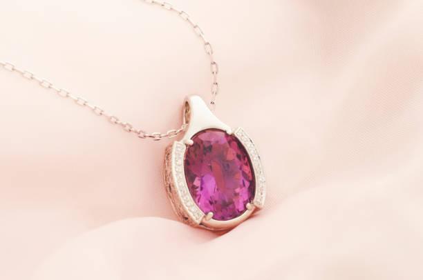 white gold pendant with amethyst and diamonds - porta retrato imagens e fotografias de stock