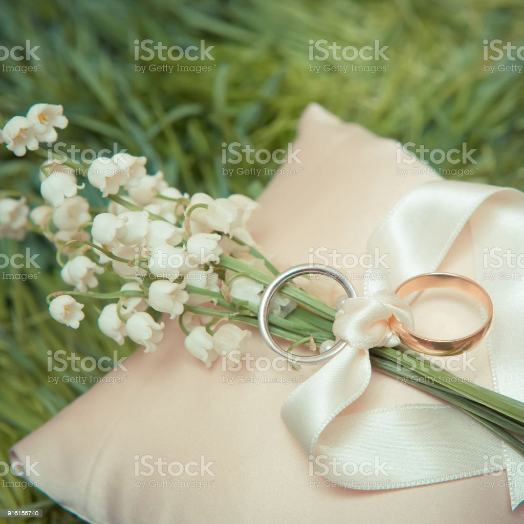 bouquet and lucky rings wedding horseshoe bridal photo with stock