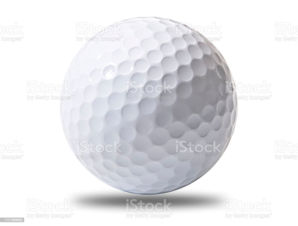 A white golf ball hovering above ground royalty-free stock photo
