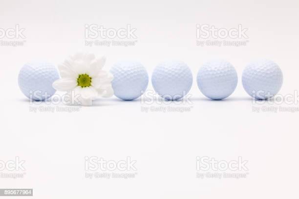 White golf balls and sping flower picture id895677964?b=1&k=6&m=895677964&s=612x612&h=ujzwi5n3hl8nmmgnheqk19vxooexaq xf1kzfrfwsqe=