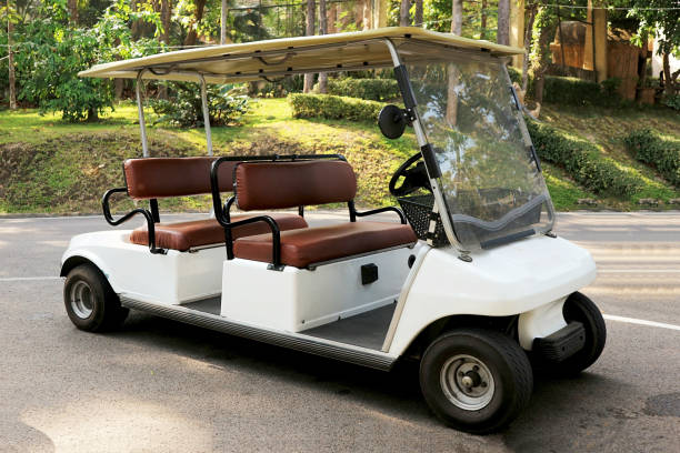 A White Golf Car A White Golf Car golf cart stock pictures, royalty-free photos & images