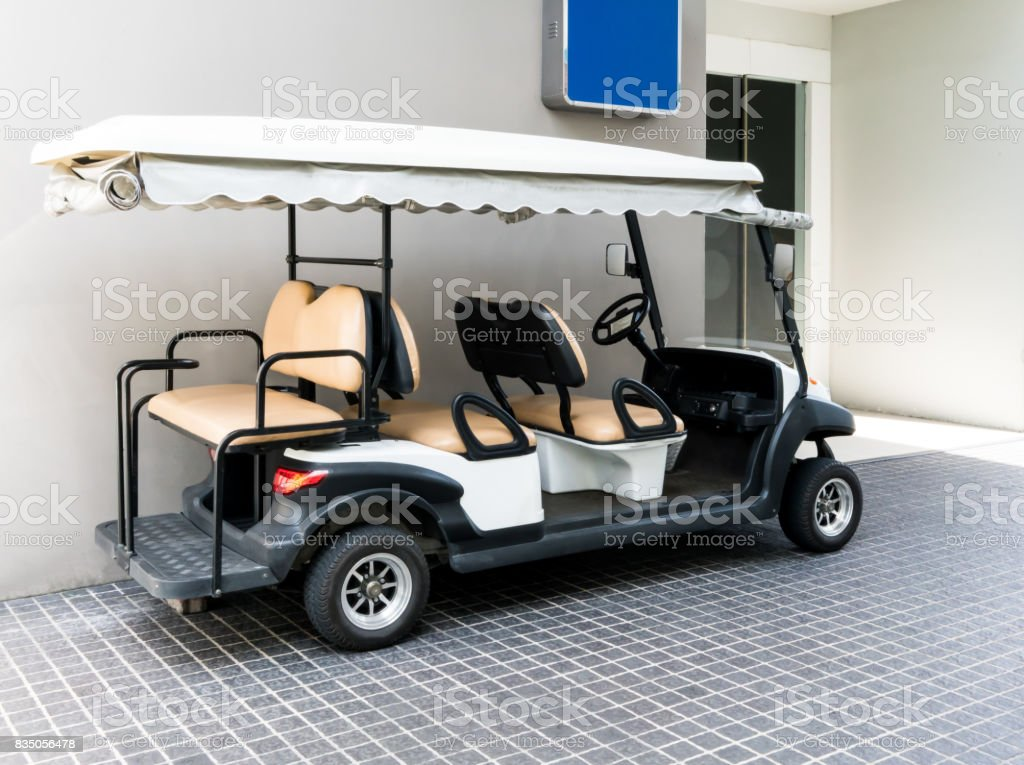 Picture of: White Golf Cart With Back Seats In The Public Building Stock Photo Download Image Now Istock