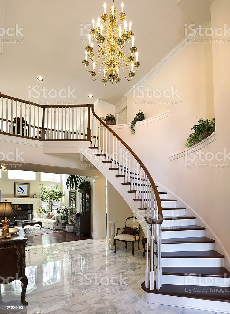 White Grand Foyer Staircase, Marble Floor Showcase Home With Chandelier stock photo