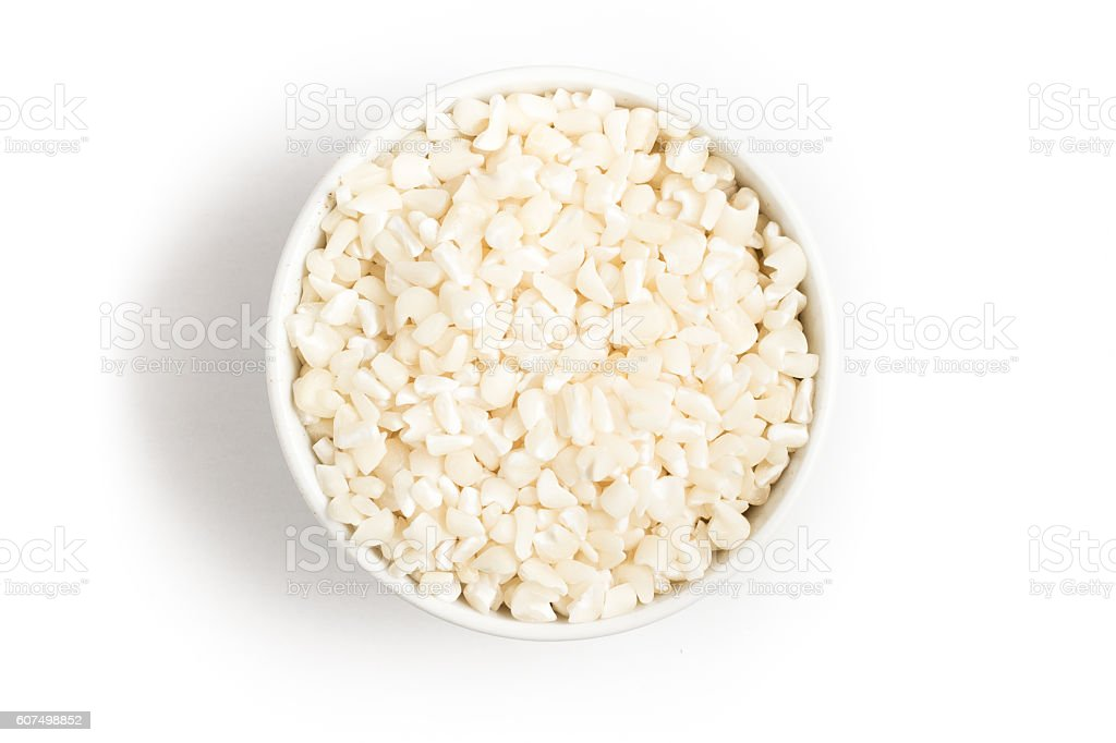 White grated corn kernels into a bowl stock photo
