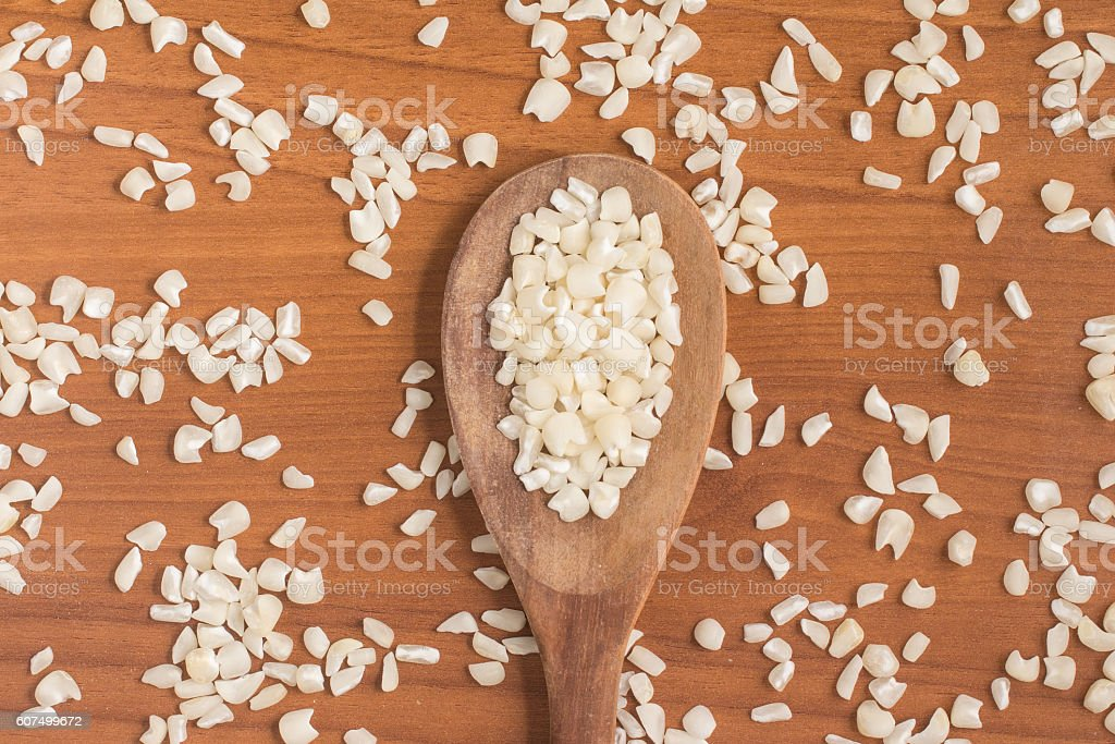White grated corn kernels into a spoon stock photo