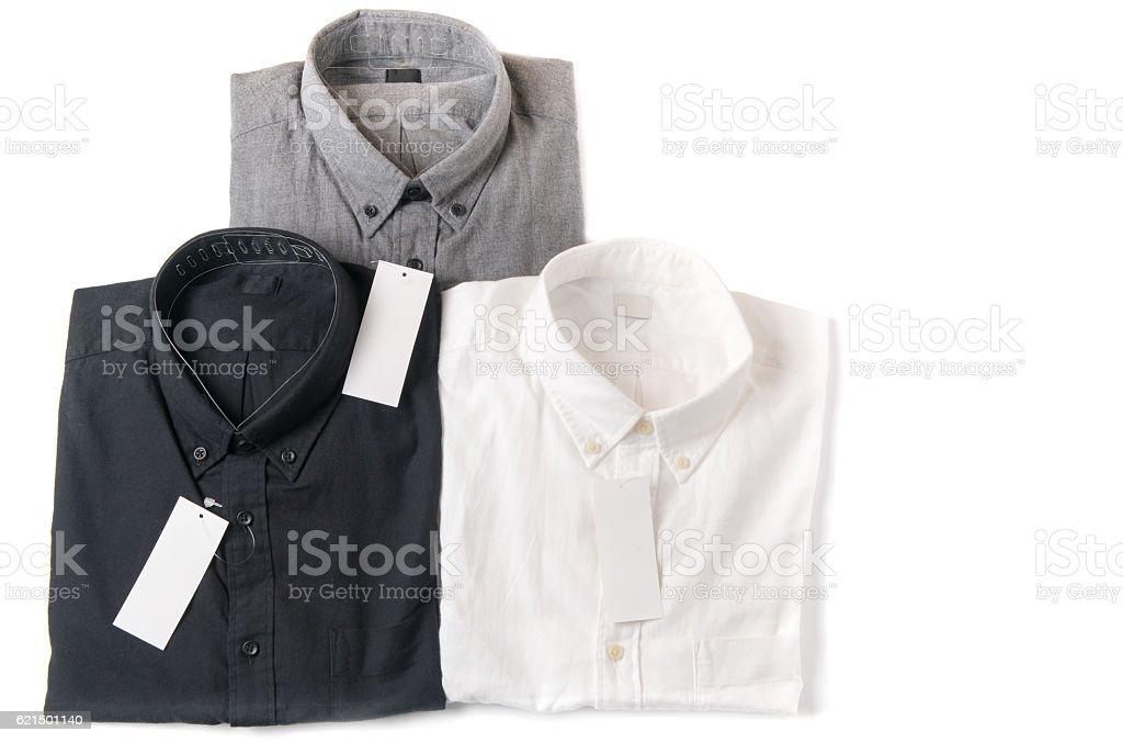 white, gray and black shirt with blank price tag Lizenzfreies stock-foto