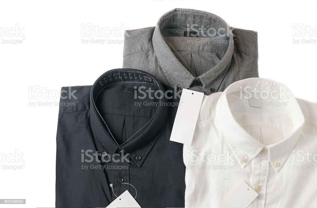 white, gray and black shirt with blank price tag stock photo