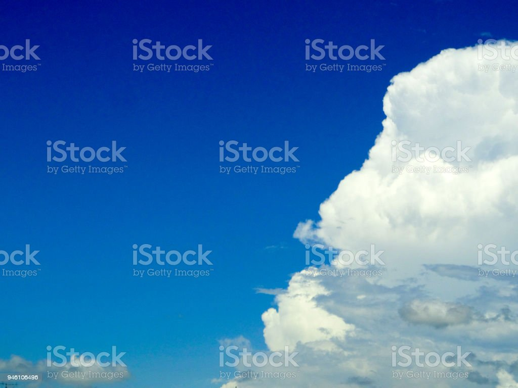 white gray cloud on right hand and clear blue sky in a day